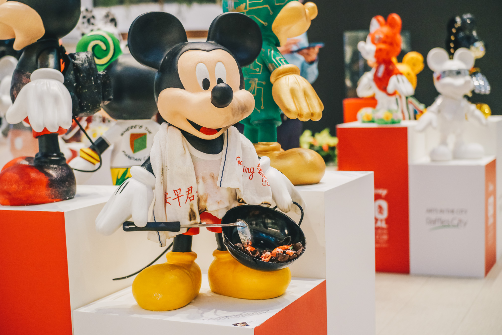 """Mickey Go Local"" - 90 Mickey Mouse Figurines on display at Raffles City Singapore"