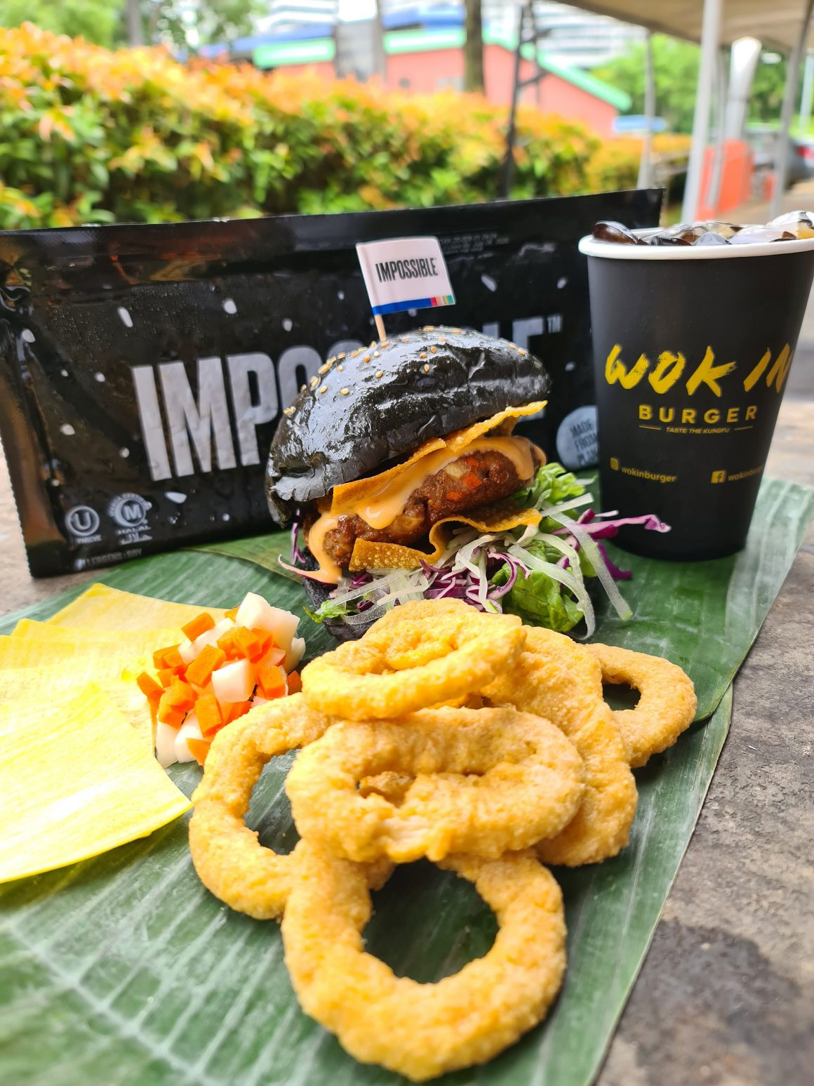 Enjoy a set meal of Impossible Wanton Burger, onion rings a drink