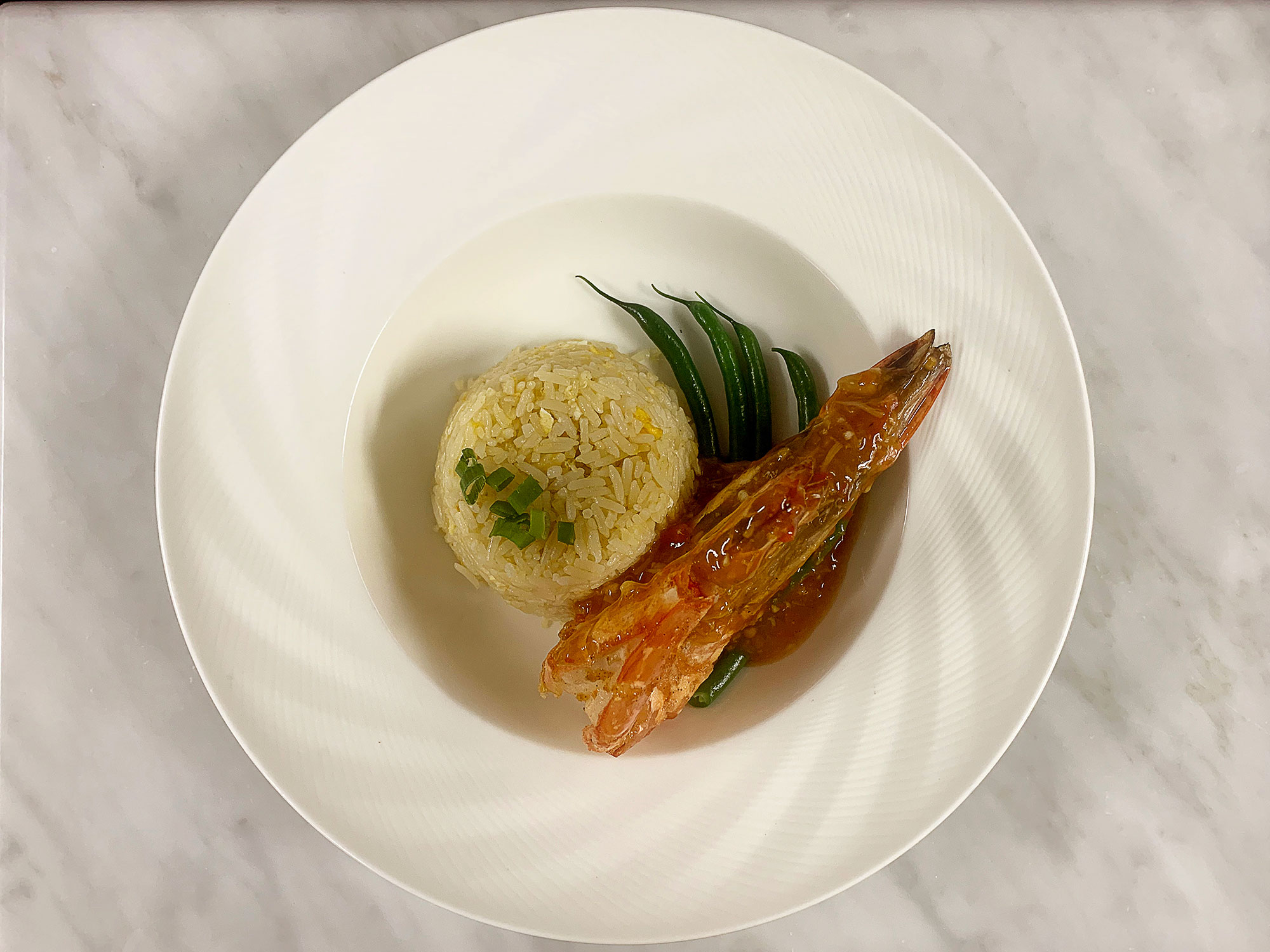 Egg-Fried-Rice-accompanied-with-Pan-fried-King-Prawn-in-Spicy-Sauce